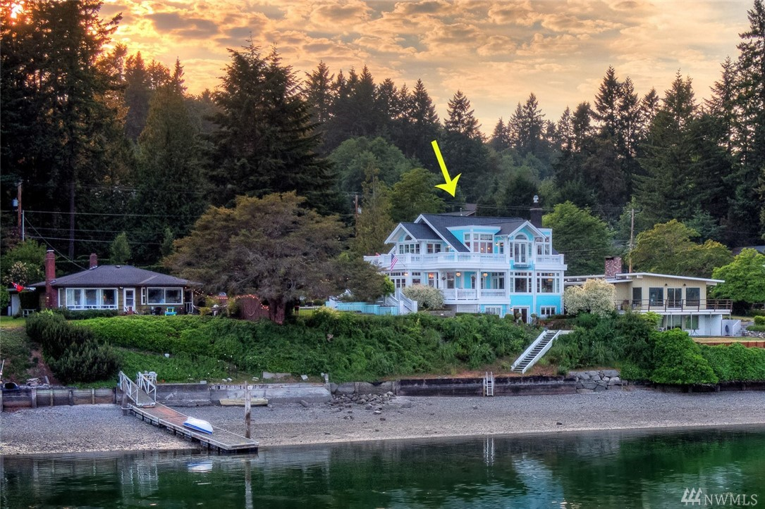 Most coveted home on Vashon.Tiffany blue jewel box sits elegantly over serene quartermaster harbor. Features 30ft vaulted foyer w/hand painted chinoiserie murals, fretwork & faux bois, chandeliers throughout, carrera countertops & baths, italian range, radiant & underfloor heating, crown moldings, lacquer built-ins, wood floors, fireplace, 97 windows & french doors, finished daylight basement, wrap porches & balconies with views over 1.57 ac. of whimsical gardens & 100ft of beachfront. Magical!