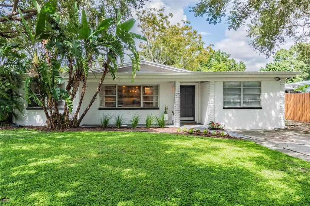 Incredible opportunity to own a piece of South Tampa. This two-bedroom home is tucked away on a great street allowing walkability to many dining and entertainment options. As you enter you are greeted with an ideal open floorplan including large living room, den/office, large front porch and expansive screened in lanai allowing plenty of room to spread out and entertain. The kitchen has been fully renovated including granite countertops, soft close cabinetry, updated lighting, Samsung appliance package and Bosch dishwasher. Both bedrooms share a renovated bath and are generous in size and closet space. There is plenty of added storage including a large laundry closet with cabinetry and folding table, linen closet and exterior storage shed. New Trane AC system was installed in 2019 and roof was replaced in 2012. The oversized driveway and parking pad provides added off street parking and room for your boat, RV or other toys. Close proximity to MacDill Airforce Base, Ballast Point, Bayshore Blvd and Downtown Tampa.
