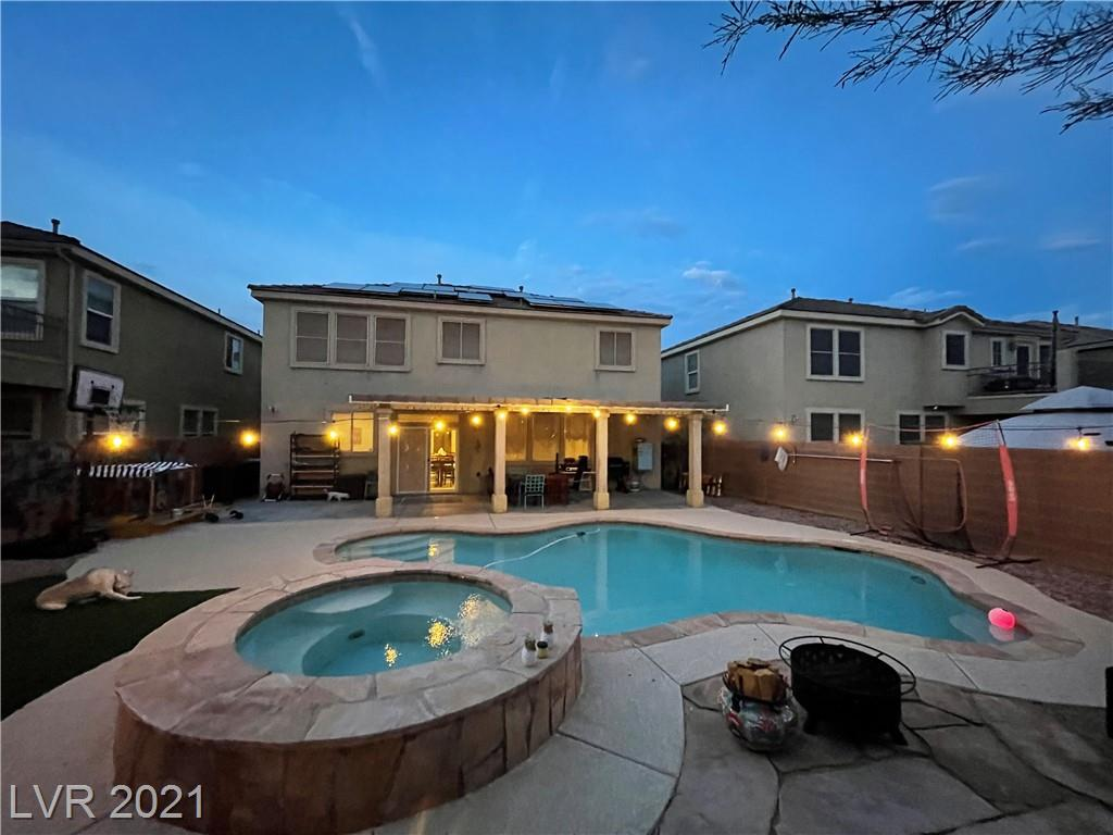 Beautiful pool home in desirable Aliante Master Planned Community. Community walking trail surrounding neighborhood. Schools and shopping in close proximity. Conveniently located near CC215 w/easy access to Nellis and Creech AFB. Well maintained updated 4 bed home w/oversized loft. Formal living and dining sep from great room/family room & kitchen. 18x18 tile in large entryway, dining, and kitch, huge walk-in pantry, subway tile backsplash in kitch & stainless steel appliances. Media nook off great room. Open, light and airy floor plan. Sparkling pool and spa in spacious backyard w/large covered patio, cool deck surrounding pool area.  Artificial grass, low maintenance  desert landscaping in front and back yards.  Recently installed solar panels to help with rising energy costs.