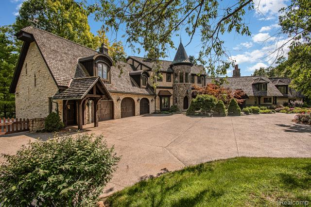 """Metamora Hunt! Gorgeous custom built French Chateau w/gated entry.All limestone,stucco,cedar shake roof,copper gutters,eyebrows, ownspouts & 18' turret. Custom doors & beamed supports w/hand carvings, handpainted walls,Rocky Mountain hardware,4"""" plank Cherry, pegged Oak,slate, limestone & tile floors. Great rm,12 ft ceiling,8' antler chandelier,Granite fireplace, archway & hearth w/hidden tv screen. 2' deep sills w/Petoskey stones & fossil inlay, grand kitchen w/Granite island, counters,pantry/office area w/laundry, SubZero st stl appl, gas cooktop. Beautiful dining rm, vaulted cllg, 2-story Granite frplc, 500 sq ft lounge w/spa bath, sitting rm, gas frplc. Huge Master w/turret,gas frplc, laundry room, custom bath, sep closets. 2 add'l bedrms PLUS 850 sq ft priv entrance in-law ste w/authentic Joe Lewis door! Wine Cellar, theatre rm, 3-4 car garage,7 doorwalls to decks,quartzite patio,inground 20x40 heated pool w/lights, jets, limestone waterfall,20 wooded acres w/trails and treehouse!"""