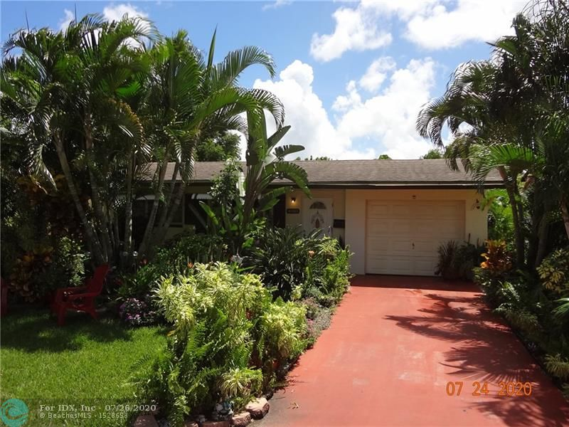 Don't miss this one! Great opportunity to acquire this nicely updated and attractive 2/2 in Mainlands of Tamarac with all the desired amenities! This home features large living room & Florida room, updated kitchen with new granite counters and new cabinets plus renovated bathrooms. Enjoy a spacious walk-in closet with custom shelving plus ceramic and new wood floors. The home has been freshly painted inside and out. A private, screened patio also awaits! You will fall in love with the fruited backyard and the lush tropical landscaping with so many places to relax or entertain in your own private paradise. The roof was replaced in 2012.  The association represents itself as housing for persons 55 years and older and requires a minimum credit score of 700. Hurry! Show & Sold!!!