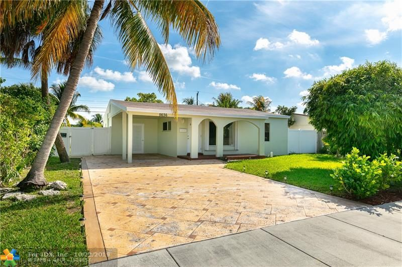 Vacant & Ready for new owner. No HOA. No Restrictions. Great starter home for first time home buyer, Airbnb or retiree. Quiet & tranquil neighborhood. Close to shopping, restaurants on Federal Hwy, I95, and just mins drive to the beach. Right by the highly sought after Coral Ridge Isles and Imperial Point. Big backyard with Fruit trees and enough room to put a pool. 3 years old Roof. New shutters. Central AIR. Circular driveway with New driveway pavers. PVC fenced in BIG backyard with Fruit Trees. All tile floorings. 5 ceiling fans fixtures. Updated bathroom and kitchen. Feature GAS stove and GAS water heater! Granite countertop. A must see in the neighborhood. Washer and Dryer inside the utility room. City Water & Sewer. Move in Ready!  $500 bonus towards buyers' closing cost at closing.
