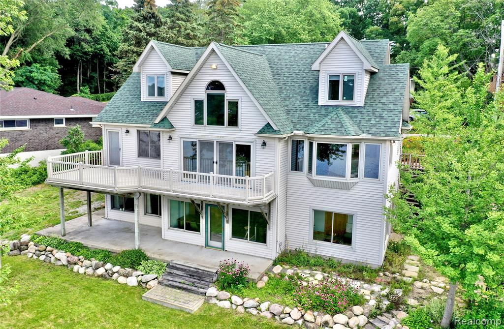 Located directly on SYLVAN/OTTER LAKE with 100 ft of frontage, this highly sought after LAKEFRONT custom-built property will knock your socks off and make you want to JUMP; not only in the lake, but into the HOME OF YOUR DREAMS. Property features giant dining/living/great room area overlooking lake w/deck access, 4 spacious bedrooms w/walk in closets, 3.1 baths, 1st floor Master w/ access to lakeside deck, 1st floor laundry, gorgeous eat-in kitchen w/granite counter tops, huge walk-in pantry, finished basement including open rec. room, sunroom, ample closet space & excess utility rooms w/ bonus refrigerator & freezer.  Under garage work-shop w/egress, solid doors throughout, casement windows, upper-level overlooking main w/lakeview, built-ins galore, a rack specific to hold fishing poles, and even hidden storage makes this home UNIQUELY SUPERB. Recent updates include roof and water-heater. Access to private park/beach- assoc. hosting year-round events. BATVAI.OPEN HOUSE 8/1/21 11am-2pm