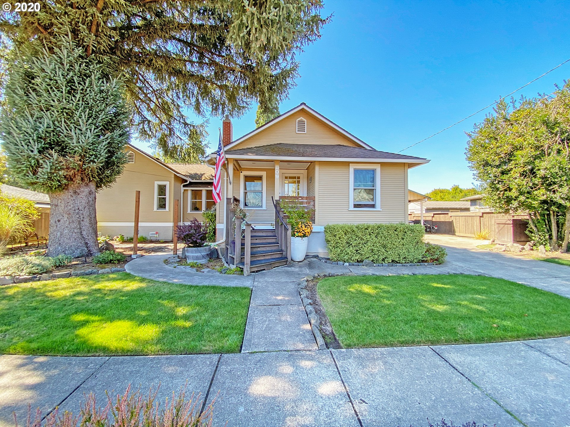 Meticulously maintained & tastefully remodeled historic home blocks to downtown Newberg. High end upgrades include Kolbe&Kolbe-double paned wood windows, newer roof, bamboo floors, nest thermostat, skylights, can lighting, gas fireplace, master suite w/walk-in closet, bath & slider to deck & covered patio. Gorgeous kitchen w/custom cabinets, pantry & Corian counters. Lots of light-Sunny & bright! Walk to shops, wineries & restaurants. Min to River-Rogers Landing. Huge 3rd bedroom. See 3D tour!