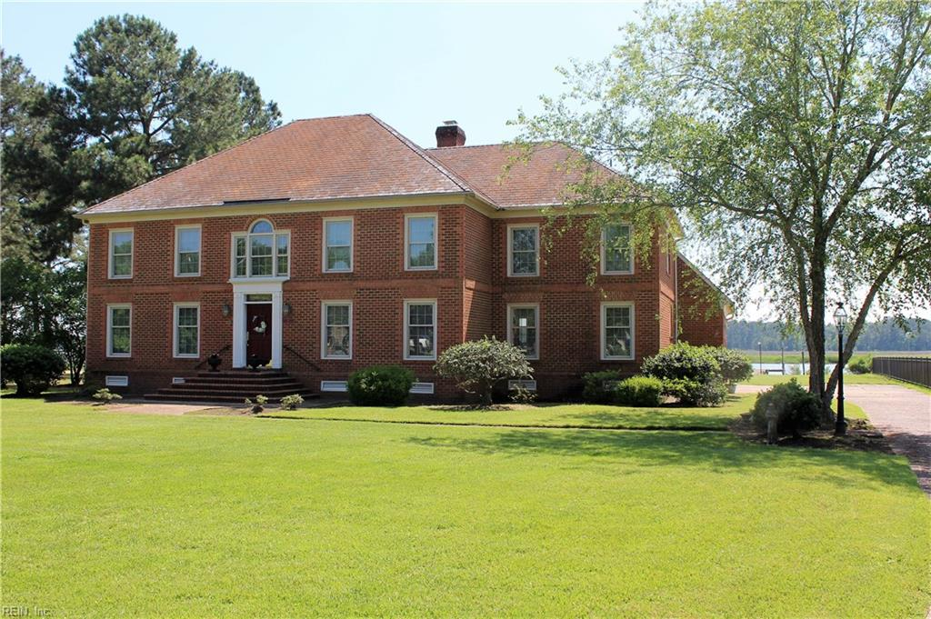 WATERFRONT, WATERFRONT,WATERFRONT! Amazing unobstructed panoramic year-round views of the Warwick River from the .85 acre property with 100 feet of waterfront. The Warwick River is a 14 mile long tidal estuary that empties into the James River. with 702 Lipton about 21/2 miles from the mouth. This full brick, 4664 sq. ft.  home offers 5 bedrooms(2masters); 3.5 baths; office/BR5/nursery and a separate game room for that special ping pong or pool table for entertainment, plus a water view. Beautiful hard wood floors on the first level.   Water views from most rooms, including both masters. Central vacuum and intercom add extra convenience. Enormous brand-new deck in 2019 extends the entire length of the back of the house. Bask in the sun or use the large retractable awning. Enjoy the beautiful sun rises and sunsets over the river. Participate in the many water sports available-boating, canoeing, kayaking and fishing. This property not only offers a home but also a lifestyle.