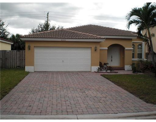 Great home in gated community right across the street from the Coconut Creek Promenade. Large private backyard no neighbors behind you!! Great floor plan with tile throughout living areas.  Nice  open floor plan, large master bedroom with large walk in closet and roman tub master bath. Accordion shutters.  Super low HOA fees. Hurry, will not last.