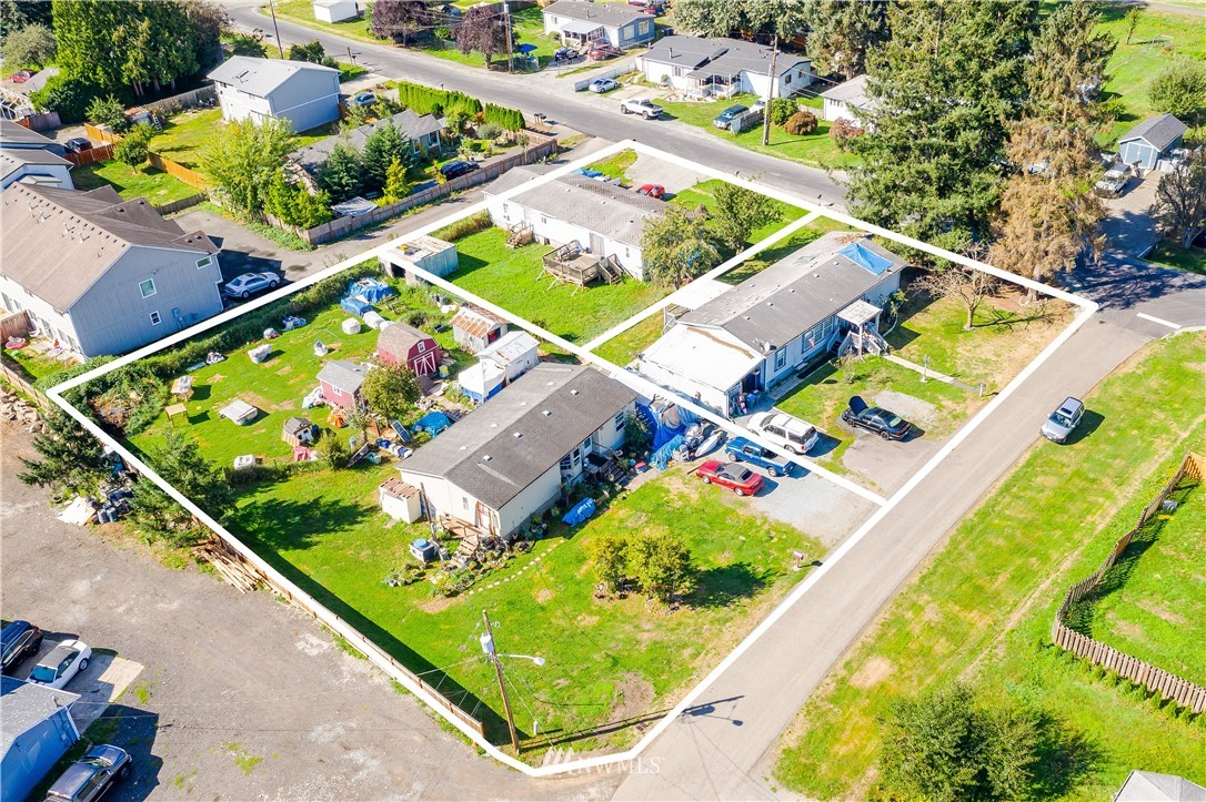 Investor Alert! So many possibilities for this 4 lot Mixed Use Property with 3 established homes. Gas in street. Property 316 4th Ave S: 1983 MH w/1200 sq.ft., 2 bed/2ba on a solid concrete foundation | 404 Tacoma Blvd. S: 1993 MH w/1700 sq.ft., 4 bed/2ba, tied down  |  302 4th Ave S:  1994 MH w/1700 sq.ft., 3bed/2ba and tied down. MH manufactured year are approximated as is Sq.Ft.Call broker for any questions.