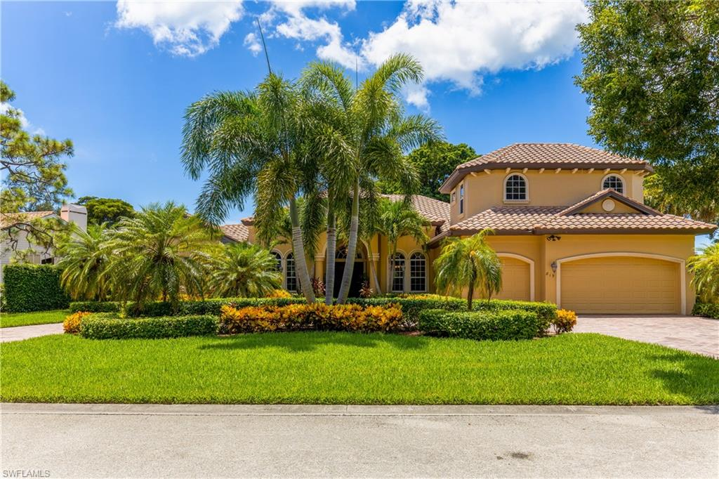 """This large estate home , in the heart of Pelican Bay, boasts 5 bedrooms plus den, 4 and a half baths, large """"his and her"""" walk-in closets with sold wood shelving in the master bedroom, 3-car garage, hardwood and tile floors throughout, gourmet kitchen with granite counter tops, stainless steel appliances and wine cooler, impact windows and doors. Exterior features lush tropical landscape and paved circular driveway. Pelican Bay is located between the Ritz Carlton to the north and the upscale Waterside Shops & Restaurants to the south. It is true resort style living with 3 miles of pristine beachfront, restaurants and beach services, kayak and canoes provided for resident use,  an attended fitness center and tennis courts."""