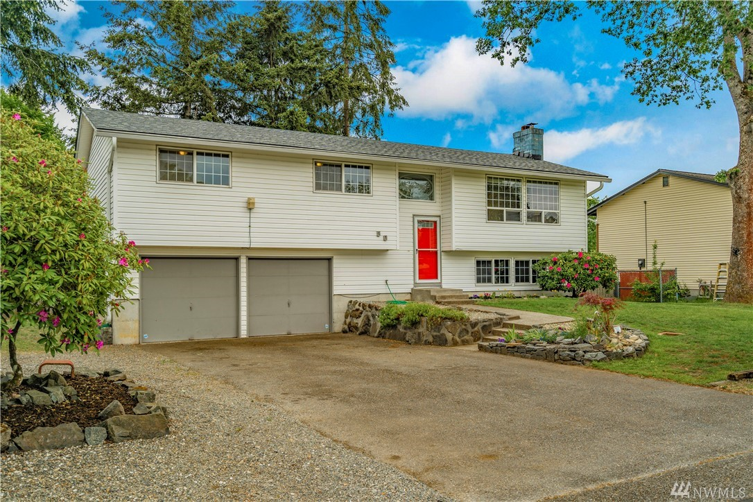 Beautiful split-level home in charming Steilacoom. New roof, carpet, interior paint, and interior craftsman trim.  Large fenced backyard w/ raised garden beds, fruit trees and elevated deck with partial views of Olympics. Five minute walk from Steilacoom HS and near park with playground. Easy commute to JBLM. Large open lower level is excellent for family room, den or could serve as an independent ADU.  With fireplaces both upstairs and down, you will always feel cozy and at home.