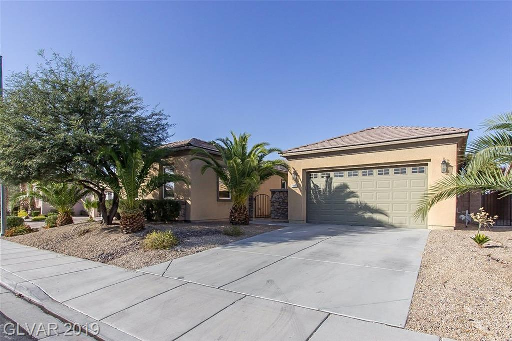 This Henderson one-story offers granite kitchen countertops, stainless steel appliances, additional living area, a covered patio, and a two-car garage.