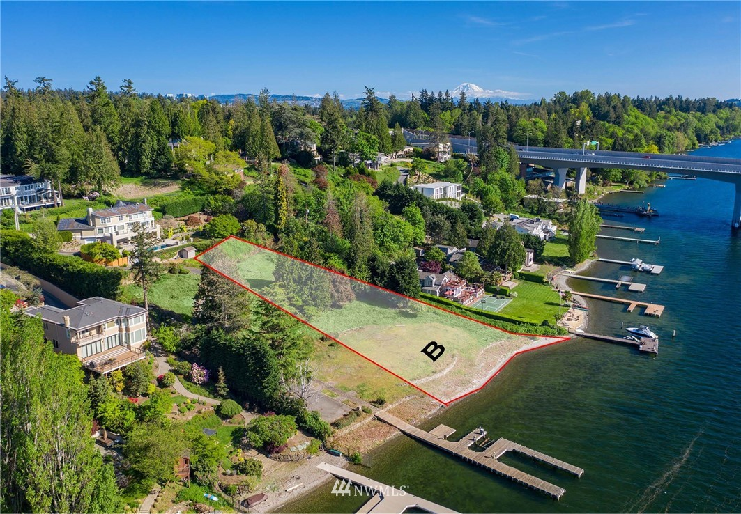 An unmatched development opportunity on pristine waterfront. Lot B is approximately .68 acre (29,660 sq ft) with 114 feet of waterfront. Lot B could accommodate a 7,000-9,000 sq ft home under current code.  Buyer to verify.  This low bank, west-facing location is pole-position on one of the most coveted stretches on the shores of Lake Washington.  Adjacent Lot A is also available for purchase.