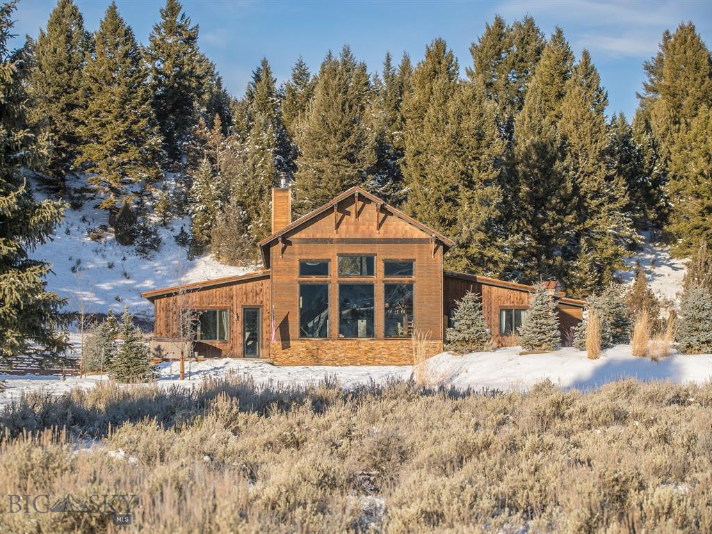 A unique property that inspires a sense of sanctuary and retreat. This spacious 4 BED, 6 BATH home includes a large recreation room, home theater and wet bar for entertaining and offers breathtaking views. All this situated on a private 3.33 acre park-like setting full of Montana's abundant wildlife! In close proximity to year round recreational activities such as 4-wheel, dirt bike, snowmobile, and horseback riding on local trail systems right from home to several National Forest trails. Covenants allow an additional horse barn or shop with guest apartment and a 1 acre corral. The large back yard has a fenced chicken coupe and old growth trees. Only 20 minutes to Big Sky Ski Resort and Moonlight Basin, 45 minutes to West Yellowstone. Property is a fully furnished turn-key vacation rental that sleeps 18. Agent owned.