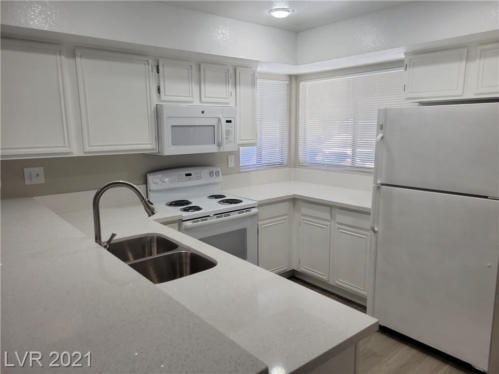FULLY RENOVATED and upgraded Condo!  Granite countertops, new flooring, new paint and new fixtures throughout!  This two story, two bedroom condo with a fireplace won't last.  Great location being minutes from the Las Vegas strip! This place is a gem.