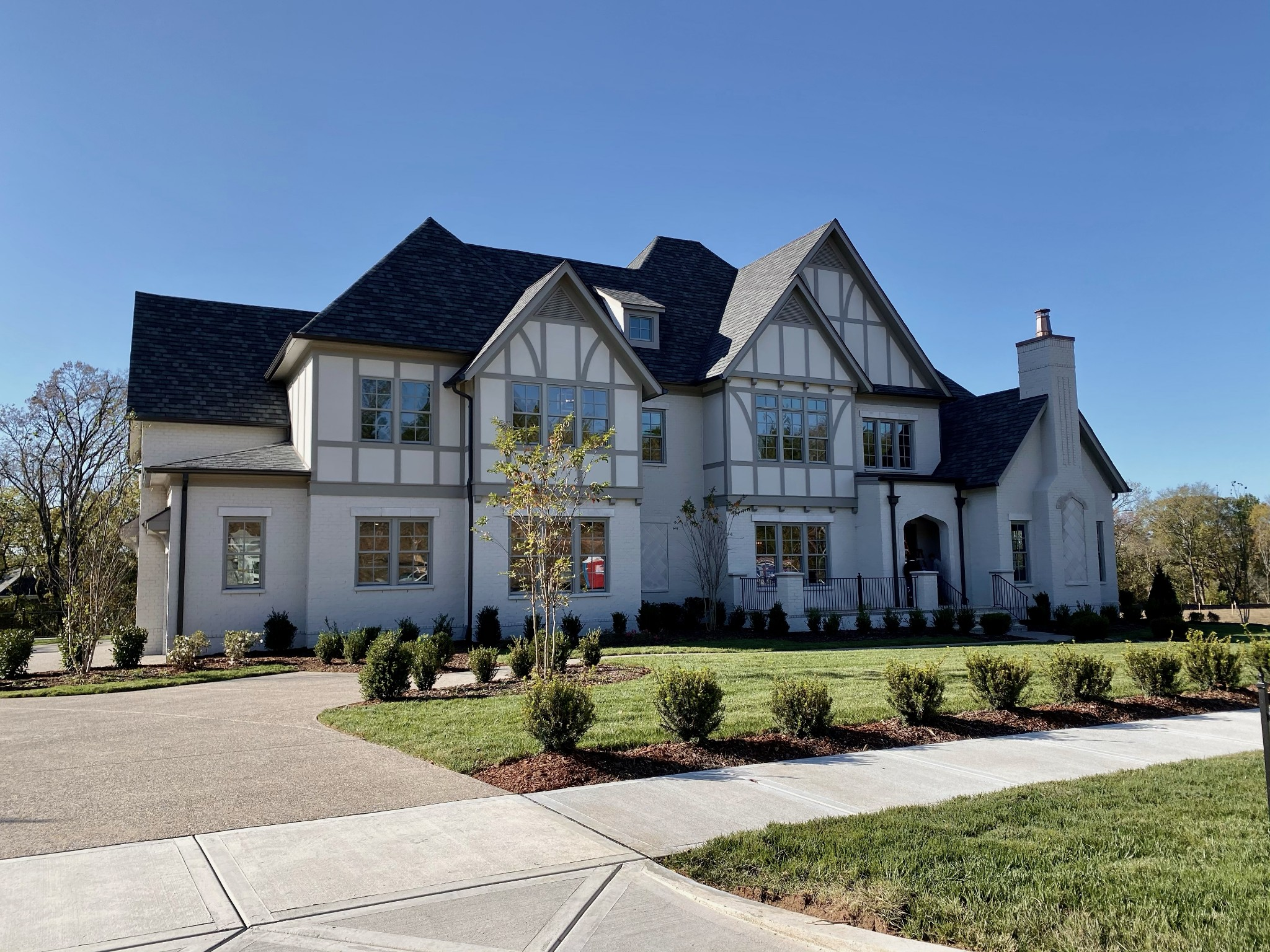 Custom Beauty in Witherspoon by Ford Classic Homes.  Classic English Architecture defines this fabulous home w/6 Bdrms/6 Full/3 Half Baths! Master & Guest Suites on main level. Elevator to all 3 floors! Beautiful porches overlook a treed backyard. 4 car garage. Large Home Center/Laundry Room/Mudroom Drop Zone/2 staircases/Wine Room/Exercise Room/Flex Rooms! You name it-this home has it! Hurry and select interior colors!