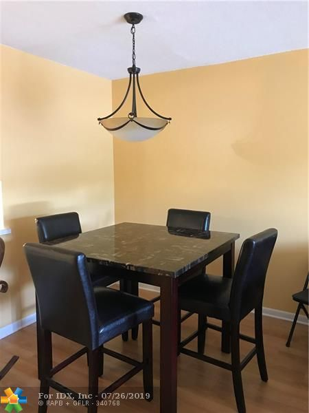 Beautiful and tastefully decorated 2/2 condo turn key, ready to move right in. Relaxing view of the canal from enclosed patio. Clubhouse, swimming pool, cable, Wi-Fi, Canadian station. Impact door and windows.