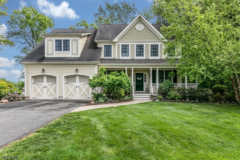 Nestled into a private cul de sac, this custom built COLONIAL HOME perfectly blends comfort with elegance. Meticulously maintained,  this home is ready for you to move into!  Higher ceilings and sunlit rooms make every room inviting. The first floor features a two story entry foyer with arched entrance to both the formal living room and dining room. The family room with wood burning fireplace  opens to the fabulous gourmet kitchen. The kitchen features a center island, Viking stainless steel appliances and a window seat!  It also opens to the deck and patio that over looks the  park like property!.A bedroom and full bath complete the first floor. The second floor has 4 bedrooms, including the expansive master suite with spa like bath, walk in closet and sitting room. TOO MUCH TO MENTION....
