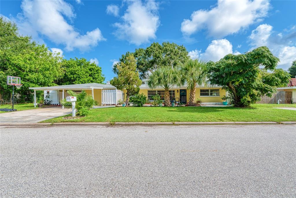 Welcome to the coveted neighborhood of Southgate, a peaceful centrally located neighborhood in the heart of Sarasota. Nestled on the Blossom Creek, this gorgeous property with over 2,600 square feet is the perfect place to call home. A highly desirable split floorplan is ideal for the most discerning of buyers. All three bedrooms are spacious, and both full bathrooms have been tastefully updated. One of the jewels of this home is the massive living spaces. Both the living room and family room are large and offer a plethora of uses. The huge covered patio is the perfect place to take advantage of our beautiful Florida nature. The one car garage could be used as either a garage or even a fourth bedroom or craft room! Storage is no issue here as the closets are great size, there is additional storage space in the garage and storage area off the kitchen. For additional peace of mind, this property had been lovingly maintained and most of the large, most expensive items have been addressed: roof is approximately four years, AC one year, water heater one year, electrical panel was updated and the house was re-plumbed! It is just waiting for the next owner to make it home!