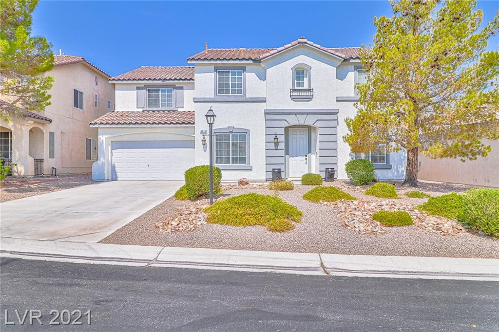 Fabulous Northwest home with recently painted exterior with modern paint scheme. Home is located in a desirable smaller gated community with mountain views. Extended front driveway that can fit multiple vehicles as well as a 3 car tandem garage for projects, vehicle or extra storage. An inviting entry to the home with plank style laminate flooring & a Den for your home office or can be used as a 5th bedroom. Granite countertops throughout the home with upgraded fixtures & hardware. Large open concept family room with custom stone entertainment nook that flows into the kitchen with an oversized kitchen island, upgraded stainless steel appliances & butlers pantry. Upstairs boasts a large loft/2nd family room. Oversized master bedroom with sitting room. Carpeting recently installed upstairs! Water heater & water softener have been replaced. Lovely park across the street from the community. Low maintenance desert landscaping.