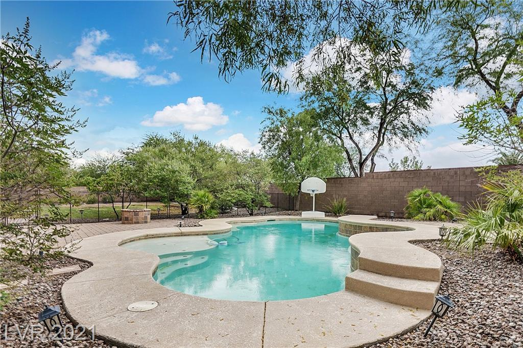 OPEN HOUSE SUNDAY JULY 25TH FROM 12-3PM. ONE STORY HOME WITH POOL IN GATED COMMUNITY ON .38 ACRE LOT WITH RV PARKING AND 3 CAR EPOXY GARAGE!  GORGEOUS NEIGHBORHOOD WITH ROOMY SPACES IN BETWEEN HOMES AND PLEASING ARCHITECTURE. BACKYARD PATIO, GRASSY LAWN, POOL & SPA & /FIREPIT WITH CHILD SAFETY GATE. MASSIVE KITCHEN WITH ISLAND, GRANITE, STONE FLOORING. PLANTATION SHUTTERS AND BLINDS THROUGHOUT, HUGE LAUNDRY ROOM & PLENTY OF CLOSET SPACE IN EACH ROOM, INCLUDING HUGE WALK IN AT MASTER. 3 OF THE 4 BEDROOMS ARE EN-SUITE BATHROOMS. THE ENTIRE HOME WAS FRESHLY PAINTED.  A NEW WATER SOFTNER AS WELL AS APPLIANCES CONVEY WITH THE SALE! WELCOME HOME!