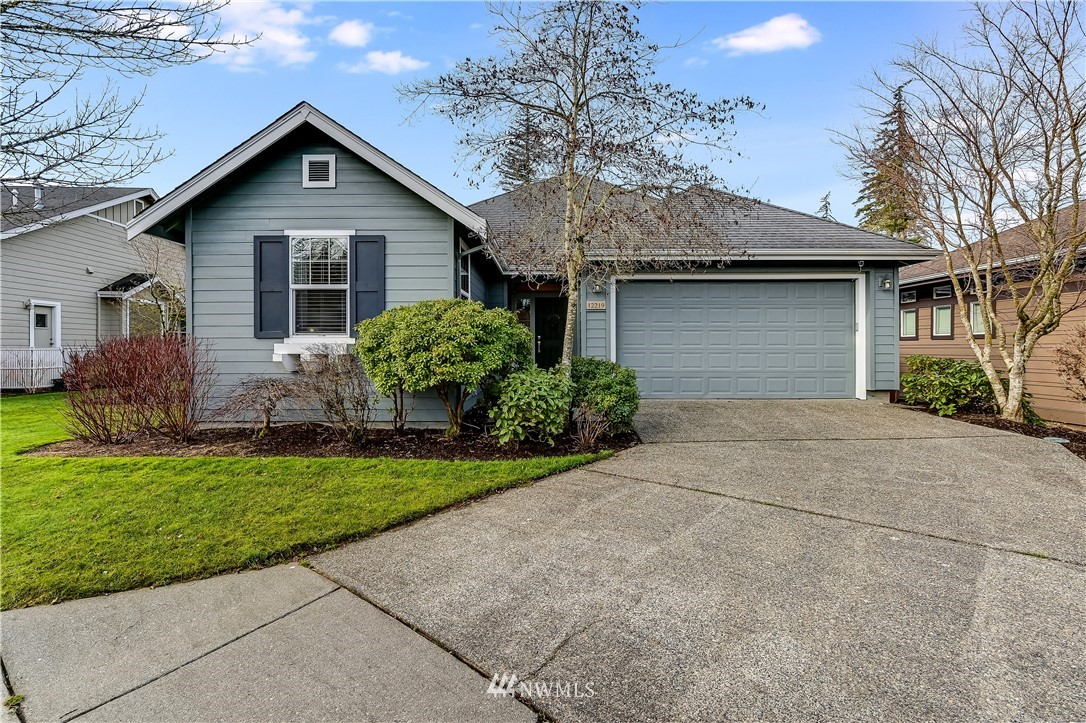 """Pristine """"Whidbey"""" model home located right across the street from the Cascade Club the social & activity hub of Trilogy. The spacious great room is flooded with natural light and is perfect for easy everyday living or entertaining a crowd. Updated kitchen features crisp white cabinetry, granite counters and stainless appliances. Owners retreat w/private bath & large walk-in closet. 2nd bedroom w/adjacent full bath. Flex Room can serve as an office or formal dining room. The covered side patio and sunny backyard creates an ideal outdoor living space. Updated gas fireplace and surround*Hardwood floors*New A/C unit in 2017*Updated interior light fixtures*Exterior paint in 2018*Extended driveway*Large shared side yard. A 55+ community."""
