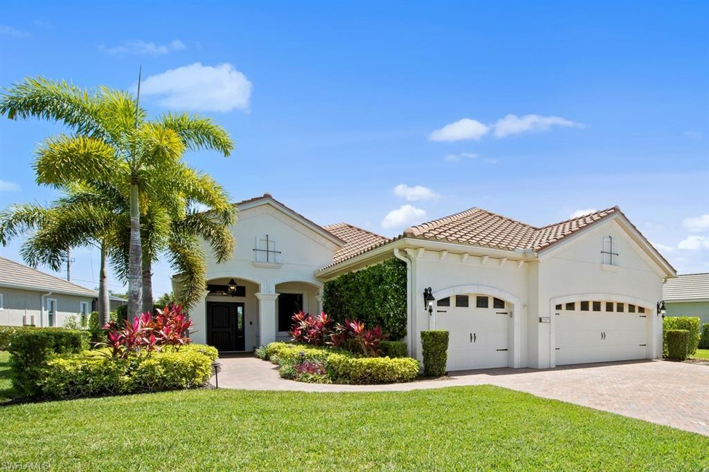 Pride of ownership shows the minute you pull up to this home. Enjoy lush landscaping with the smell of Jasmine as you approach the front porch. Enter the foyer and into the spacious great room and be wowed as you look around.  Soothing gray tones, upgraded laminate flooring, LED lighting, crown molding, fans and a tray ceiling. The kitchen boasts a wrapped island, gas cooking, soft close cabinets and drawers, tile backsplash, in cabinet and under cabinet lighting, newer dishwasher and disposal.   Owners suite has dual California closets, tray ceiling, dual sinks, w/i shower, fun floor and lighting in mirror. Guests can 2 enjoy En suite bedrooms.  Laundry has built in shelves.  Soak up the sun on the large lanai with beautiful gas heated pool and spa.  There is plenty of covered space for shade and room around the pool to put your chair and enjoy the warm Florida sunshine.  Other features:  rain gutters, impact glass, plantation shutters, overhead storage in garage, ring doorbell, nest thermostat, water softener, generator plug, newer carpet in bedrooms, keyless entry, natural gas community and more.  Close to white sand beaches, golfing, dining, parks and shopping.  See to believe