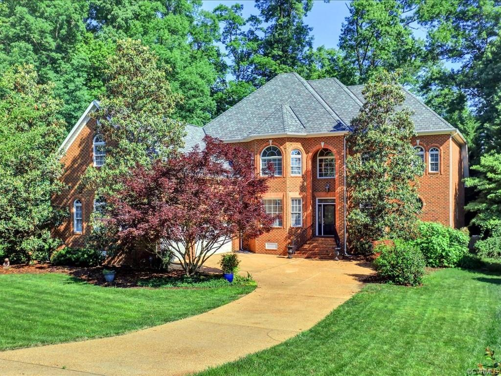 This stunning all brick lakefront home has amazing views of the Swift Creek Reservoir. Pulling into the cul-de-sac you immediately notice the beautifully manicured lawn. From the moment you step into the two-story foyer you can see all the custom details this home has to offer. Downstairs this homes features 10 ft ceilings, crown molding, recessed lighting and palladium windows thorough out both floors that capture the gorgeous water views. The kitchen features custom cabinets, granite countertops, large windows, an island and pantry for all of your storage need, Relax in your large family room that features a gas fireplace, wet bar, more beautiful water views, built-ins and recessed lighting. This home also features a first floor master bedroom with a fireplace, recessed light and access to your veranda. The master bath has everything you could ask for and more! The master bath features a jetted tub, his and her vanities as well as his and her walk-in closets. On the second story you find 9ft ceilings, five additional bedrooms that also features water views, extensive windows and a huge bonus room that would be the perfect mancave/ playroom. This home will take your breath away.