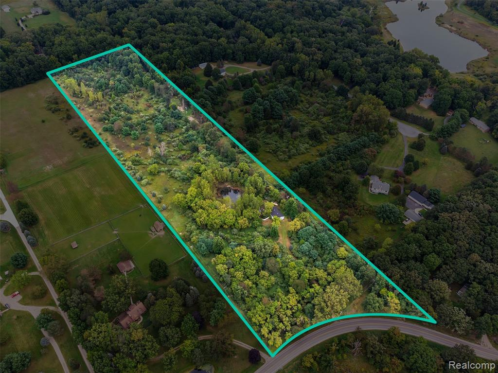 Just under 13 acres, come and take a look at one of the largest undeveloped parcels on paved Coon Lake Road. This beautiful wooded property has a serene pond and a 30X50 insulated and drywalled pole barn with cement floors. Ample storage is provided with two large lofts. Special note to car enthusiasts: there is enough ceiling height for a car hoist. Build your dream home here with a possible walkout basement or consider adding a living space onto the existing pole barn. Splits available! Overall, tons of opportunities here. Natural gas and electricity are available on the road. All lot lines are approximate. Buyer to verify all information.
