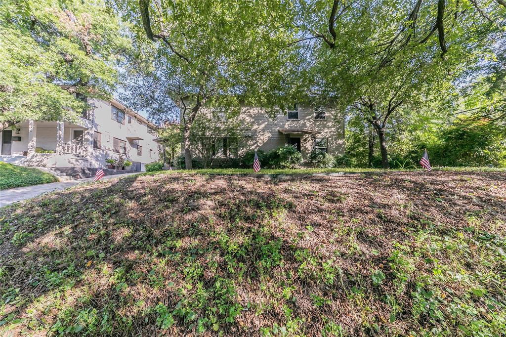 Extraordinary opportunity to invest in a corner lot with a residential duplex (2 BR, 2 BA in each) in the heart of Uptown Dallas.  This is prime Dallas real estate and would be ideal for a remodel, rebuild and-or rental.  Centrally located near Turtle Creek and Oak Lawn with beautiful tree-lined neighborhood streets within a short distance to shopping, dining, entertainment and everything that Dallas has to offer!  Home has good bones and the lot is currently zoned for a both single family or a duplex property.  Amazing real estate investment opportunity for anyone!  PROPERTY BEING SOLD AS IS. Contact us today or schedule a showing!