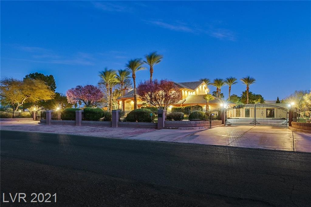 """Welcome to your desert oasis in the heart of Las Vegas!! With almost 3 full acres of manicured lush greenery, this home is truly one-of-a-kind!! Jog on your private trail, or sneak away to your fully finished detached garage. This property also boasts a fully gated separate RV or """"toy"""" yard, equipped with 3 RV hookups. Oh, Did I mention the beautiful sprawling 5,600 sq. ft main home with 5 large bedrooms, theater, 2 family rooms... the list goes on!!"""