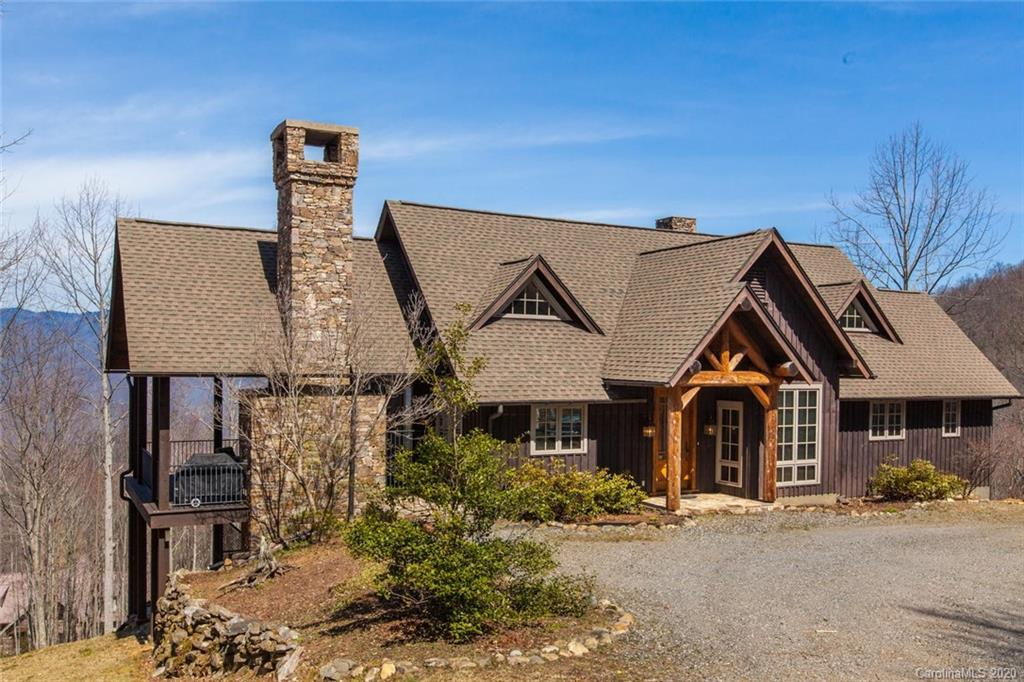 Beautiful post and beam home at Balsam Mountain Preserve!  This home features fantastic mountain views of the Plott Balsam Mountain Range and the Arnold Palmer Signature Golf Course.  Great outdoor porch and stacked stone fireplace to enjoy the views and nearby creek sounds. An open floor plan on the main level that leads to two outdoor decks is ideal for entertaining.  Both indoor and outdoor fireplaces.  Great views from the bedroom and soaking tub on the main level.  Charming downstairs living area features rustic concrete floors and a walkout terrace to plenty of yard space to enjoy!  Two large bedrooms downstairs with gorgeous mountain views.  Nestled just above 4000' of elevation, this custom home is secluded, yet just a few minutes from most amenities and new Clubhouse.  Recently reduced!