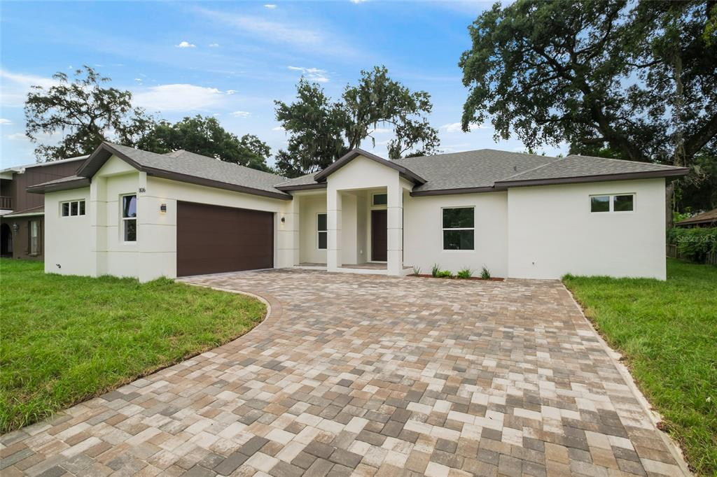 **NEW CONSTRUCTION - Completed September 2021! Check out this Spectacular Modern Ranch-Style home located in the heart of Brandon. The tile floors welcome you inside with soaring ceilings tastefully finished with a modern paint scheme. This floor plan includes 12ft high ceilings upon entry with vaulted ceilings in the kitchen, dining, great room, and designer detail 36 x 36 white porcelain tile throughout the entire home. The Dining Room/ Great Room combo is the perfect space for entertaining and enjoying home-cooked meals in your fully equipped kitchen with Stainless Steel Appliances, an Impressive Island, High-Grade Quartz Countertops and a blend of Neutral Gray and White Shaker Cabinets. Adjoining the Luxurious Master Suite, you will find Two Walk-in Closets designed to pamper you with an abundance of space for all your needs. The master bathroom is a modern sanctuary combining function and relaxation. It comes equipped with a Free Standing Tub, Large Double Vanity, Dual Sinks, and a Walk-in Shower featuring a massive Waterfall Shower Head. There are three more bedrooms, an office, and three full private bathrooms for the family. Each bedroom comes with windows strategically set to bring lots of natural light. The location is central to everything! Extremely close to everything that Brandon and the rest of Tampa have to offer. Approximately 20 minutes to downtown Tampa, about 10 minutes to Brandon Mall, and close to the crosstown and I75! Call today for additional details as this property won't last long.
