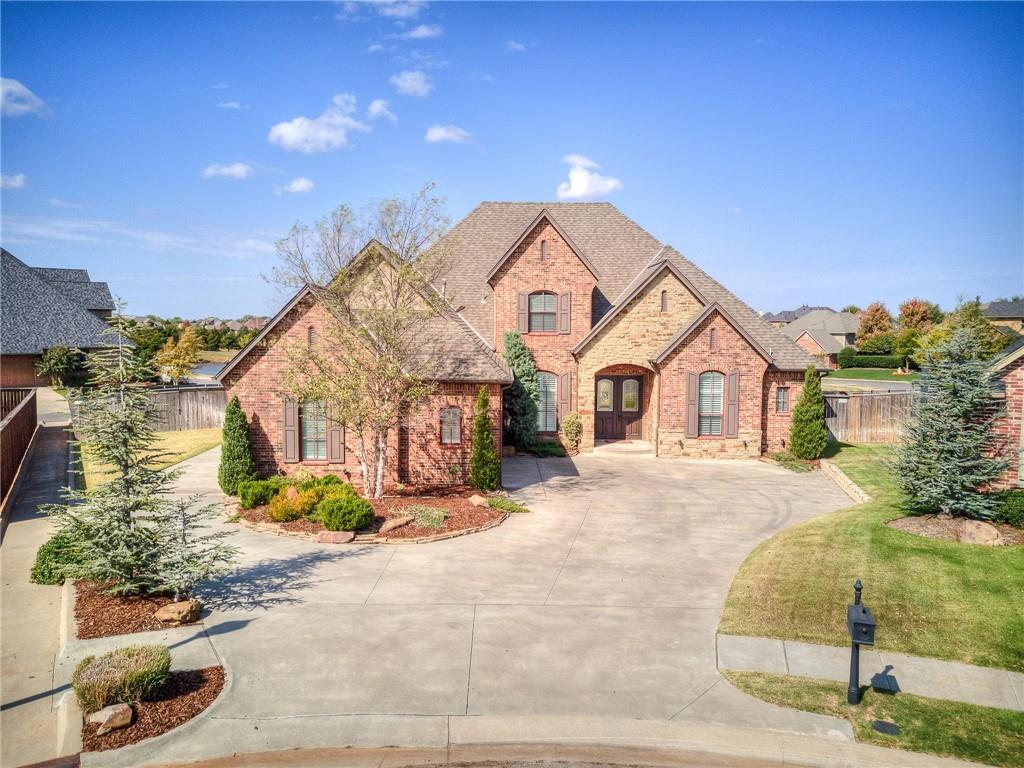Absolutely Gorgeous like new custom Justice Home in Beautiful gated Canyon Lakes Addition with award winning Deer Creek schools! Open living plan that is perfect for entertaining with stunning brick fireplace. Chef's dream kitchen with large island, double ovens, 5 burner gas range with pot filler & walk-in pantry.  4 bedrooms, 2 downstairs including Master Suite & 2 upstairs with J&J Bathroom. Study, bonus living or dining room off entry and upstairs media room with romantic balcony that overlooks 18 acre spring fed community lake. Beautiful woodwork throughout. Tons of storage including under stairway, off kitchen mud room, huge laundry room & plenty of upstairs storage. Oversized two car garage with third car garage off to the side of home for additional storage! Community lake, walking trials, pool and parks. Conveniently located to Turnpike, highways restaurants, shopping and golf/tennis clubs. Welcome Home!
