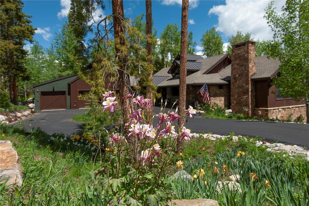 A Parade of Homes gem encircled with flowers. The designed connection to nature touches all spaces in everyday living along a rushing stream.  The first step inside reveals dramatic woodwork that turns to a stunning kitchen and brilliant great room with red oak floor extending to a south-facing covered porch overlooking the cascading creek. Three spacious suites weave smartly from the patio-level family room. Luxury, privacy, sun and storage abound. Impeccably built and immaculately maintained.