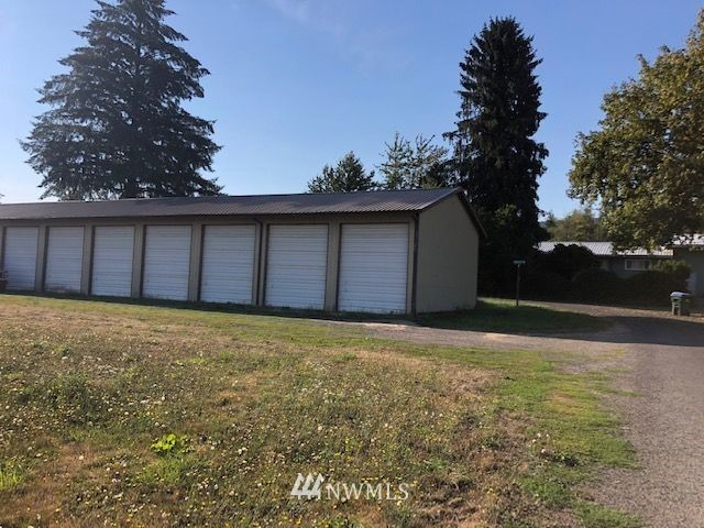 Public Storage/Warehouse with Ten 12x30' storage units all rented fulltime with good annual income. On a third of an acre lot in Mossyrock. City says that 10 more units can be added or existing units can be made into smaller units. Lots of possibilities.