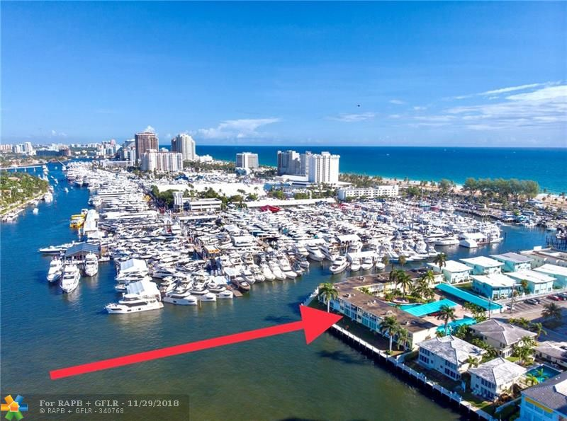 Best waterfront location & sunset views in Ft Lauderdale. Rarely available REMODELED 2BR/2BA located just South of Bahia Mar Marina & 2 blocks to the beach. Marble floors. Updated kitchen & bathrooms & impact windows, Gated & walled property with awning covered carport & designated parking. Beautiful courtyard & large heated pool.  Low maintenance fee, includes water. Well maintained Coop owns land and no recreation lease.  Quiet & restfull sanctuary two story enclave of 18 units.  Recent capital improvements include dock, carport awnings, security cameras, water & drain lines. Roof replaced in 2006. By-Laws prohibit leasing & require cash only purchases.