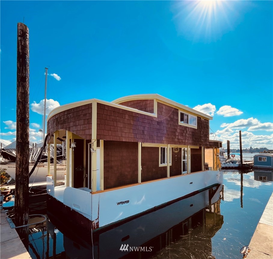 First time ever on the market! Live on the water in this cozy 2 story, cedar clad houseboat, custom built by the owner, a contractor w/ a spacious owner's suite on the main floor complete w/ full size laundry & tiled shower w/ on demand hot water. Main living on the upper floor w/ exposed wood beams, hardwood floors, quartz counters, Bertazzoni Italian Range, Kohler Stainless sink & full size fridge. Tiny living without sacrificing everything you need plus a craft space, office space, 3 decks, 500SF of easily accessible storage in the hull. Don't miss the spectacular view of the Capitol from the upper deck. Moorage ($431-460month) covers water, power, garbage, pump out & parking & is already paid through June 2022! House can be relocated.