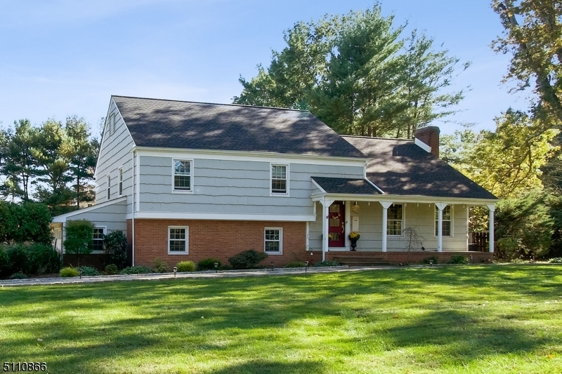 """Beautiful split level home situated on an expansive level lot on south side of Scotch Plains. Perfect """"staycation"""" home with salt water pool on approximately an acre of land."""