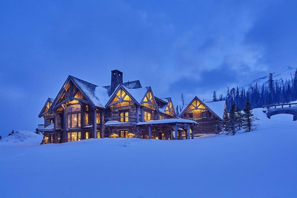 Exceptional does not begin to describe this unique residence in Moonlight Basin. Perched above the ski run, the custom home is both elegant & comfortable. Large timbers accentuate exterior & interior spaces & are complemented by two massive stone fireplaces spanning all three stories of the home. Six bedrooms, two of which are bunk rooms, flank each side of the home while a large living area, kitchen, game room, dining area, theater, ski room & laundry encompass the lower level. Guest quarters above garage.
