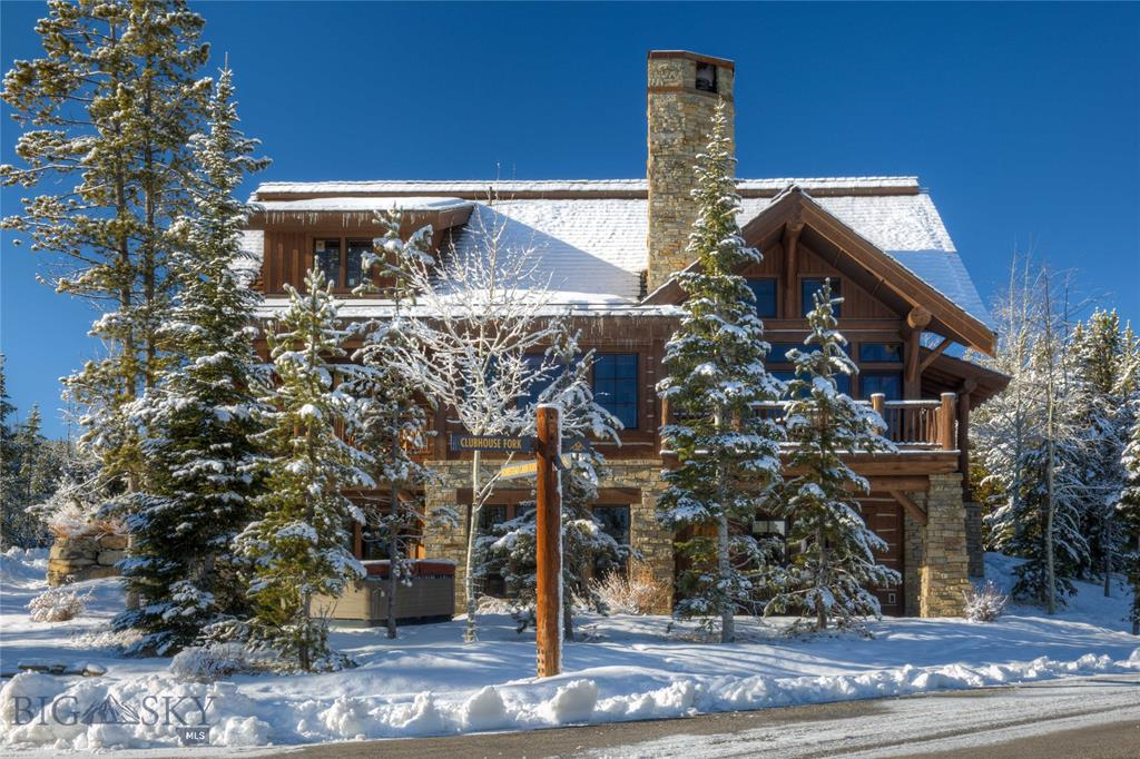 This beautiful cabin nestled in the heart of Spanish Peaks Mountain Club offers 4 bedrooms, 6 baths, 3 fireplaces (2 indoor  and 1 outdoor), hot tub, and a spacious living area. The home is designed with rustic mountain style furnishings, including hard wood floors, log beam vaulted ceilings and stainless steel appliances. Enjoy the ease of ski-in/ski-out access, and end the day with a cozy fire on your private porch. The home is only a short walk to the Spanish Peaks Clubhouse where you can enjoy a fine dining experience, or relax at the newly renovated bar. This cabin offers the true Montana experience. Offered Fully Furnished.