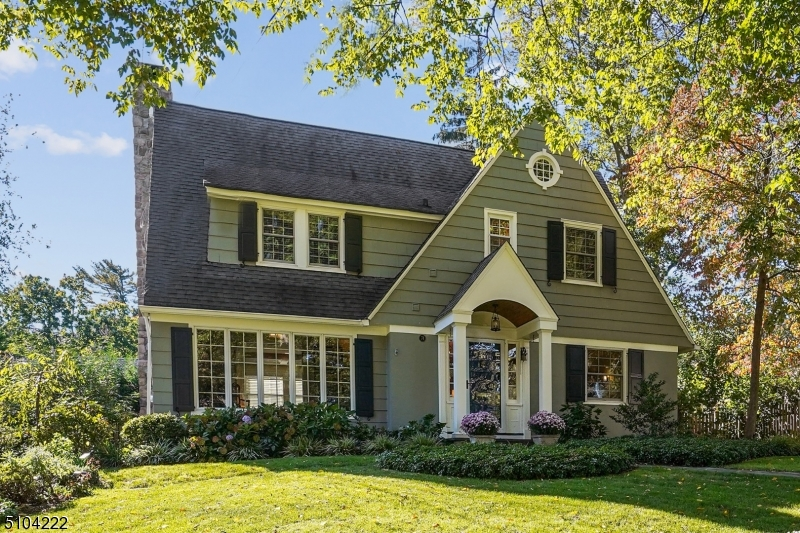 This very special Center Hall Colonial in the Knollwood Section of Short Hills has been totally redone from top to bottom; remodeled for today's lifestyle while retaining its original charm. Its front to back foyer is flanked by a formal dining room and a fireside living room with layered millwork and French doors that lead to a private study/den.The heart of the home is its custom eat-in chef's kitchen with Viking, Wolf, Bosch, and Sub-Zero appliances, honed Absolute Black granite counters, and sliding doors that spill out to an inviting patio enhanced with speakers and a gas line to hook-up a grill. Upstairs features two en-suite bedrooms and two additional bedrooms served by a hall bath, while downstairs the fabulous lower level offers a family room, full bath, built-in dual work stations, and custom laundry center. Other perks include a mud room, two-car garage, extra parking, and herb garden in the front yard. Best of all is the location only blocks from Millburn Middle School, downtown Millburn, and Midtown Direct service to NYC. Welcome home!