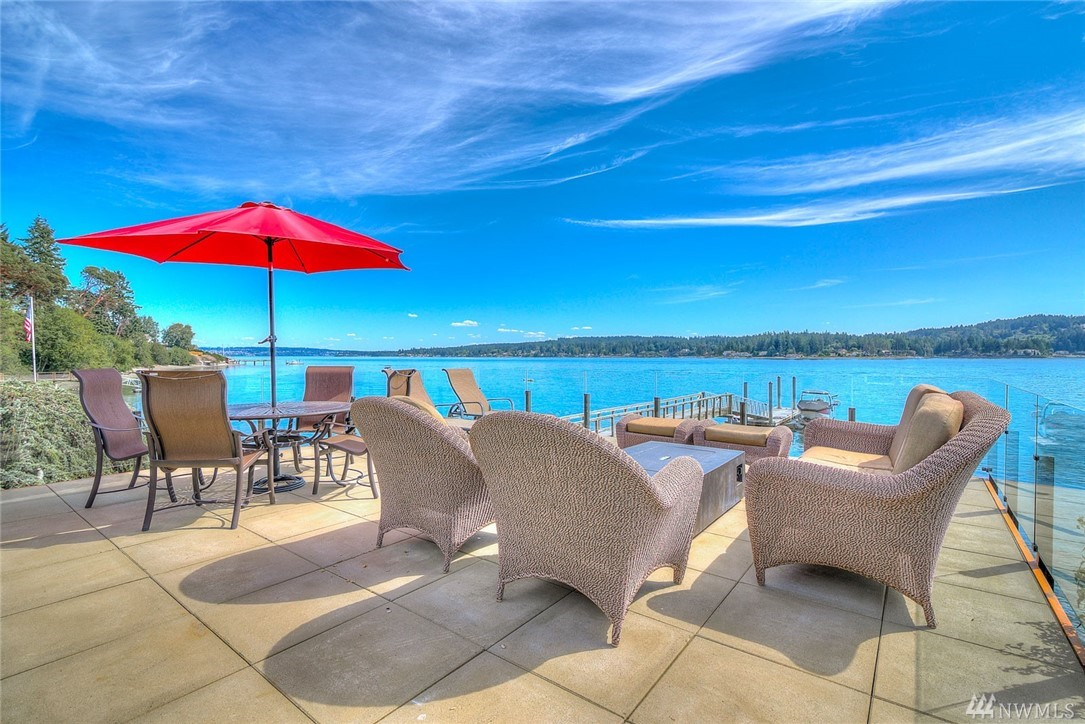 From Sunrise to Sunset this hard to find Southern Exposure Cromwell Beach 103 ft. low bank waterfront playground on 1.06 acres with sweeping views of Hales Passage & Fox Island has it all!150 dock w/float, boat launch, waterside deck & entertaining areas abound. Exquisite meticulously rebuilt from top to bottom, Master Retreat on main, Magnificent chef's kitchen with open concept great room. Like a vacation every day!