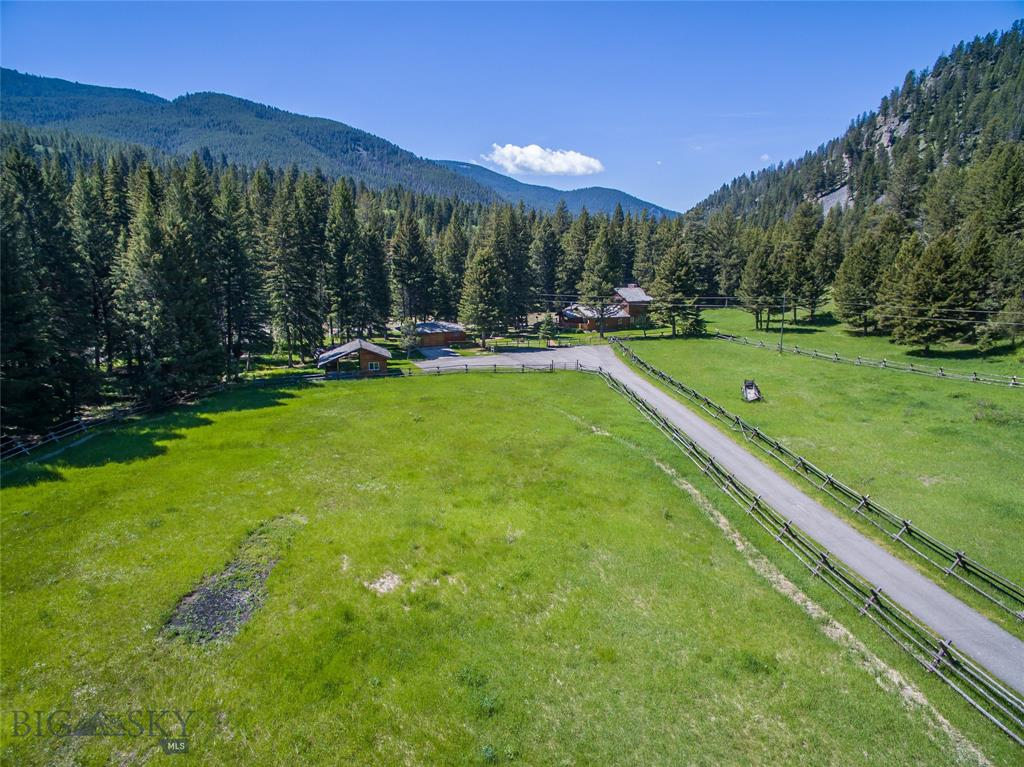 This is an extremely rare vacant lot right on the banks of the Gallatin River! This 4.3 acres lot is on the other side of the highway, accessible year-round by the private Golden Gate bridge. With over 300 feet of river frontage, this parcel is a dream equestrian and/or fisherman's paradise.