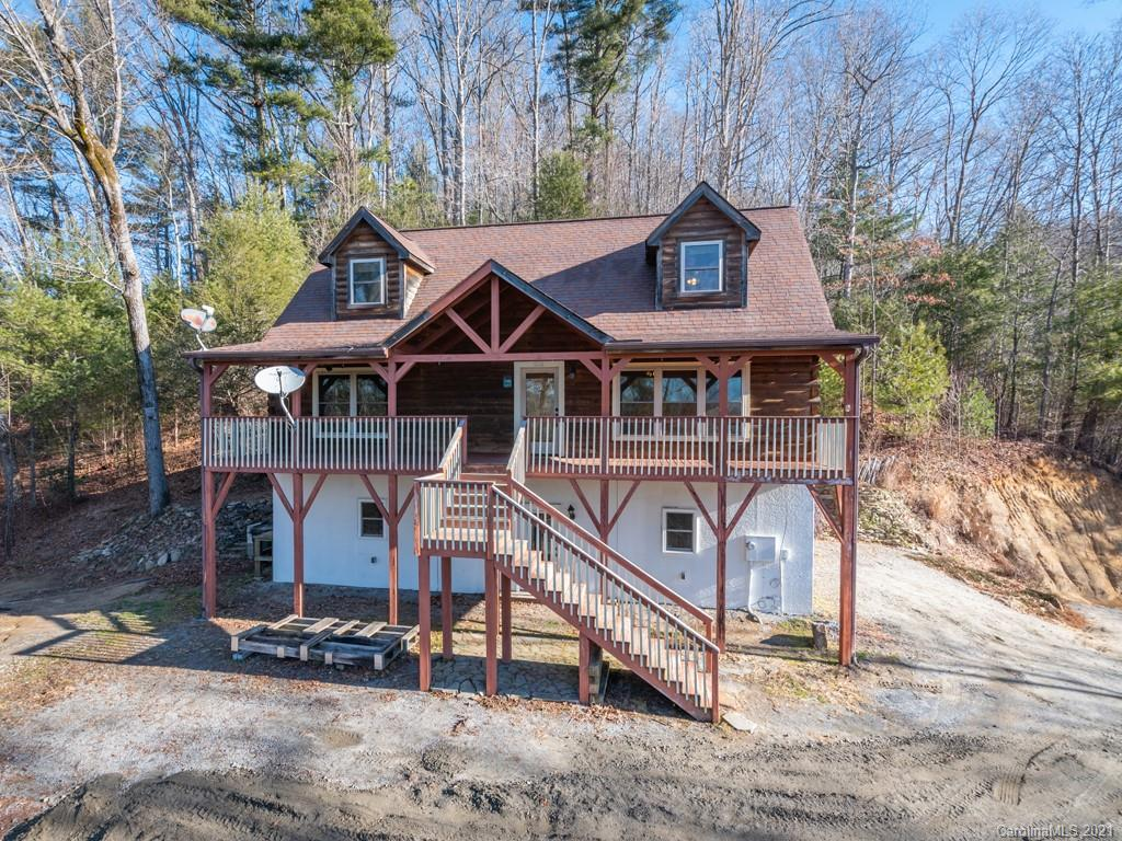 "This lovely 3BR/2.5BA Blue Ridge Log Home is nestled on 1.29  luscious acres in the River Ridge Subdivision, which boarders the NC Game lands. Take advantage of year round mountain views (southern exposure).  The master is on the main living and the basement is plumbed and ready to be finished.  This would make a great full time home, or an excellent ""Mountain Retreat"".  Having access to the Hungry River allows you to enjoy adventures such as swimming, tubbing, or trout fishing. There is a water softener and radon mitigation system installed.   If you are looking for a mountain hideaway, this is the place for you. Conveniently located close to I-26 and great restaurants."
