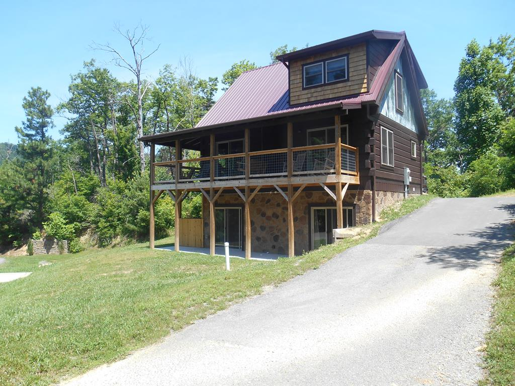 This beautiful, two-year-old log style cabin has 3 stories, 3 bedrooms, and 3 baths. This cabin is fully furnished and ready to rent or move into. There is plenty of parking available for your guests. This gated resort has great mountain views, and a pool to enjoy those warm summer days.  The new hot tub is perfect for those cool fall nights is ready to relax in. Open floor plan with electric fireplace for your year-round use. The kitchen and bathrooms have granite countertops. Plenty of closet space in each bedroom. The bedrooms on each floor have their own private bath. This cabin is all wood inside and out with a wrap-around deck. Lots of windows and glass doors for natural light. Grossed $68,000 from August to August for 20-21. Easy access to Gatlinburg, Pigeon Forge, Dollywood, and the Great Smoky Mountains National Park. Outback Resort is secluded yet has the convenience of being close to the places you will want to visit.