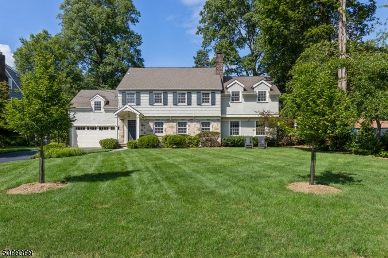 Meticulously maintained and beautifully updated 1930s Colonial w/4 BRs, 3 bths, + 2-car garage, is nestled in the heart of the Wychwood section of Westfield. Close to schools, downtown, parks, + more. An inviting entry opens to a bright LR w/a gas fireplace. Flow to the beautiful formal DR with a charming corner cupboard and spacious and stylish EIK appointed with granite counters, custom cabinetry, SS appliances, and a center island. A breakfast nook has a wall of oversized windows looking out on the property, and a French door to the patio and lushly landscaped back yard. The 2nd floor includes a lavish primary BR suite w/WIC, sitting room, and bathroom w/glass shower and dual sinks. There are 3 additional BRs and a full hall bath. The lower level offers a rec room, laundry, and plenty of storage space.