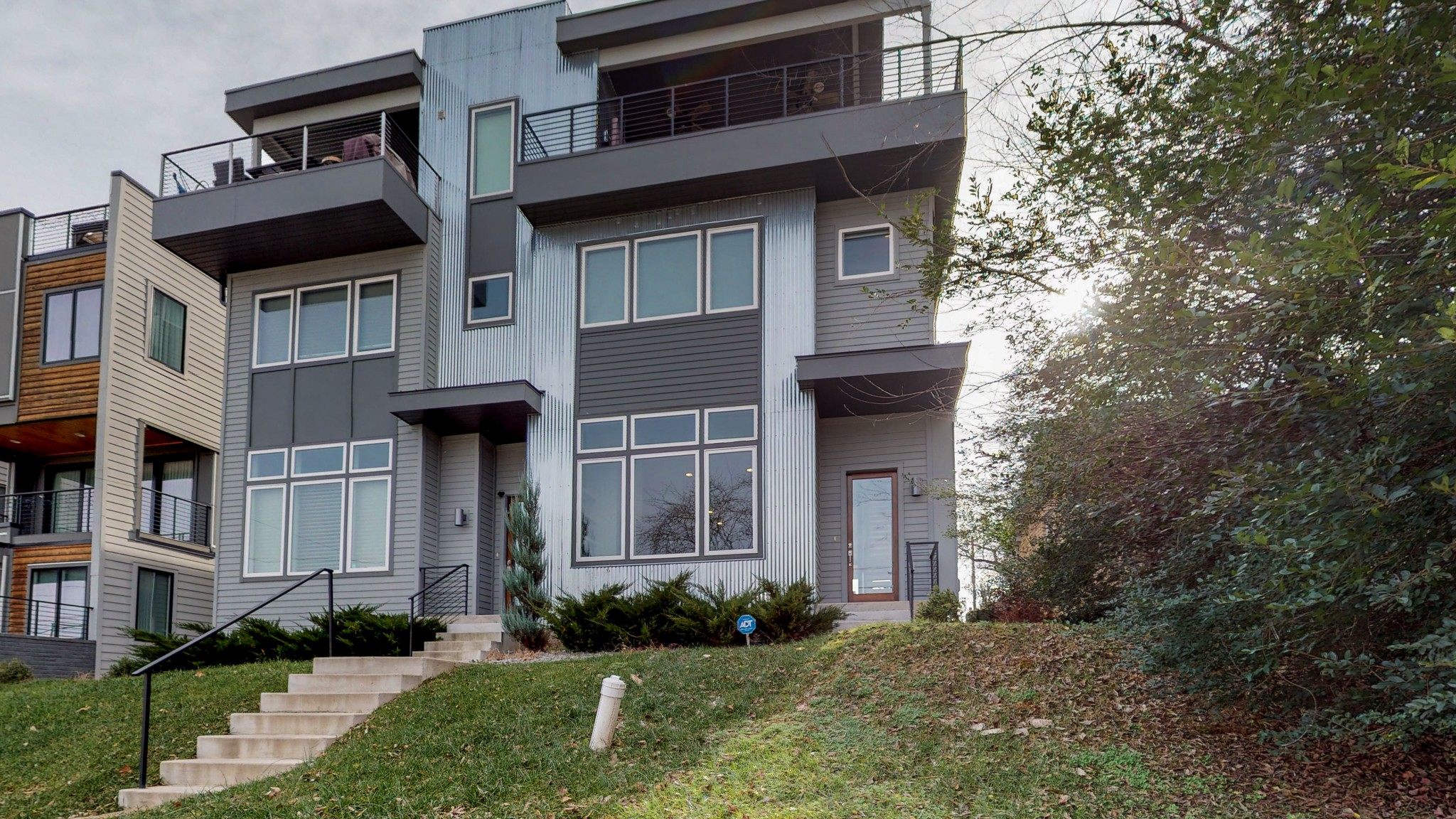 Modern luxury home located minutes away  from downtown Nashville. Stunning view of Nashville's skyline. This home features an open-concept floor-plan, hardwood flooring, walk-in closets, garage style sliding door to access the rooftop deck.