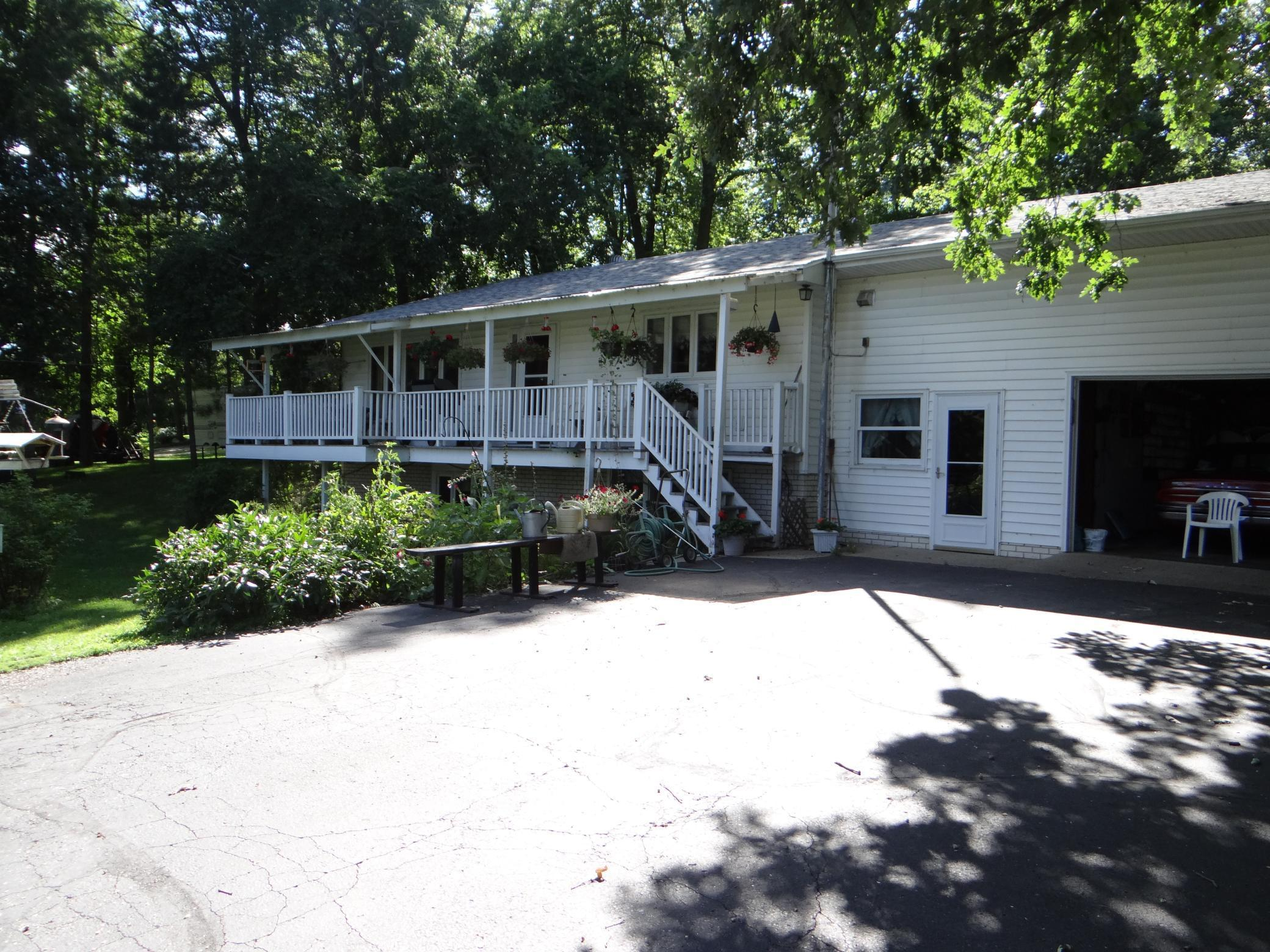 Property is tucked back off the street on the back side of the 1.5 acres with lots of mature trees. Property is a side split level with the entry having extra living space and storage above the garage with an outside entrance to it.  Behind all Paneling on the wall there is sheet rock.