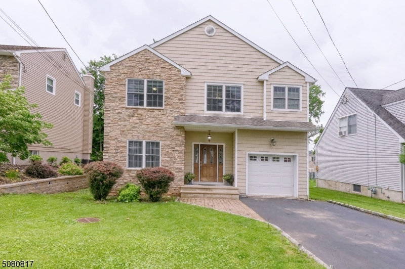 Dream location! Expansive, one of the newest homes in the neighborhood located on a quiet st & close to NYC trains & buses. Access to Rt 287, 78, GSP & NJTP. Exceptional school & community offerings. Well-maintained, renovated colonial house offers an open and spacious floor plan. Wide & high ceiling are naturally bright w hardwoods thru-out the 1st floor. Open layout of the LR/DR and kitchen/family rm opens up in the backyard patio. 2nd floor offers a Mstr Suite w a mstr bath and WIC along with a guest room, office, an extra BR & laundry. The pull-down stairs attic provides additional storage space. A partially finished lower-level basement spans the entire length of the structure and has a great potential to be used as a finished media/entertainment space. 1 car attached garage with 2 extra parking spaces.