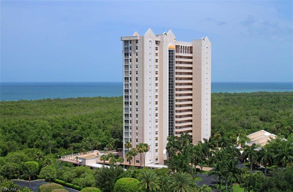 Magnificent views of the Gulf of Mexico from this turn-key furnished 7th floor, end-unit. This home is in excellent condition & boost new wood flooring & new furniture. Interior features, separate den with new French doors & full-sized sleeper sofa. The den leads to open lanai that features new glass railings for unobstructed views. There is also a glassed-in lanai for year around use. Kitchen includes granite counters, stainless appliances & stackable washer-dryer. The master bedroom includes a beautiful, remodeled vanity area & master bathroom. Guest bedroom turns into an en-suite with pocket door that separates from living areas. St Maarten amenities include gym, pool-spa, billiards room, library & 2 guest suites. Pelican Bay amenities includes miles of walking paths, 2 private beachfront restaurants, tennis, & fitness center. St. Maarten has had several recent improvements - new exterior paint, new hurricane windows & doors, new security cameras in common areas & building access has been upgraded to a mobile app.  You will appreciate the convenience of the on-site management company. Located next to S. Beach Tram station, walking distance to beach, Commons & tennis courts.
