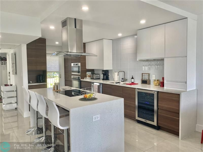 Back on the market motivated sellers bought a new house. Nothing like this unit in Palm Aire. All doors and windows are impact everything in this corner unit had been approved by the city of Pompano Bech. All appliances are new with 5 years of warranty. Induction cooktop wall even and microwave together. Very unique design, den was converted in a dinning room but can also a 3rd bedroom. New a/c and new hot water heater. All the furniture is negotiable. Condo fees $1,421 Quaterly including Hi Definition and High Speed internet.